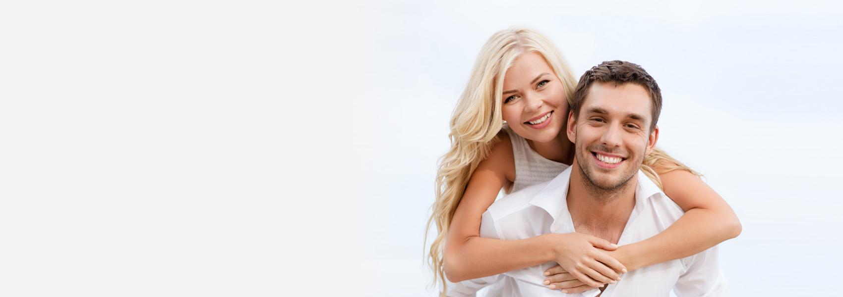 woman embraces man, both smiling